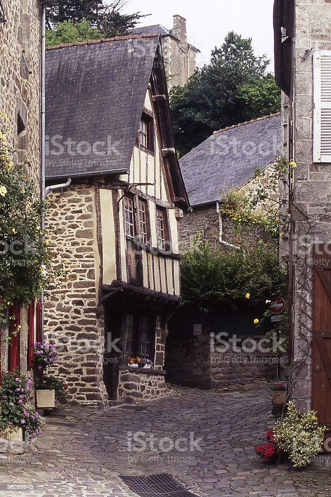 Narrow Cobbled Street in Dinan, Brittany, France royalty-free stock photo