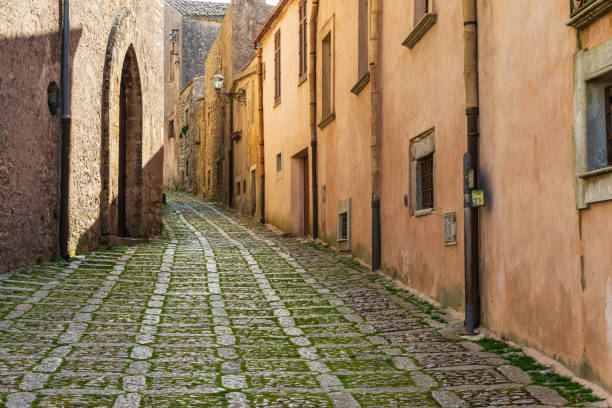 A narrow cobblestone street in the ancient hill town of Erice. stock photo