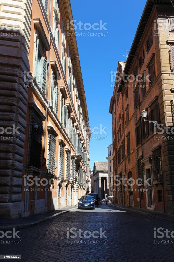 Narrow Cobblestone Street with Historic Stucco Houses, Rome, Italy. royalty-free stock photo