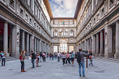 Florence, Italy – April 10, 2017: Narrow courtyard the Uffizi Gallery  between palace's two wings