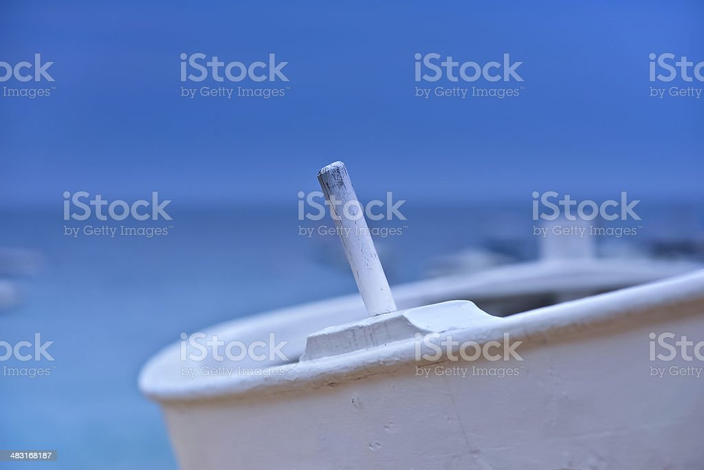 Narrow depth of field close up of white oar pin. stock photo
