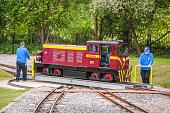 London, England - May 2017 : Narrow gauge tourist train locomotive changing railtracks, Ruislip Lido, London, UK