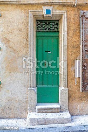 Narrow Green Door at House In Arles France