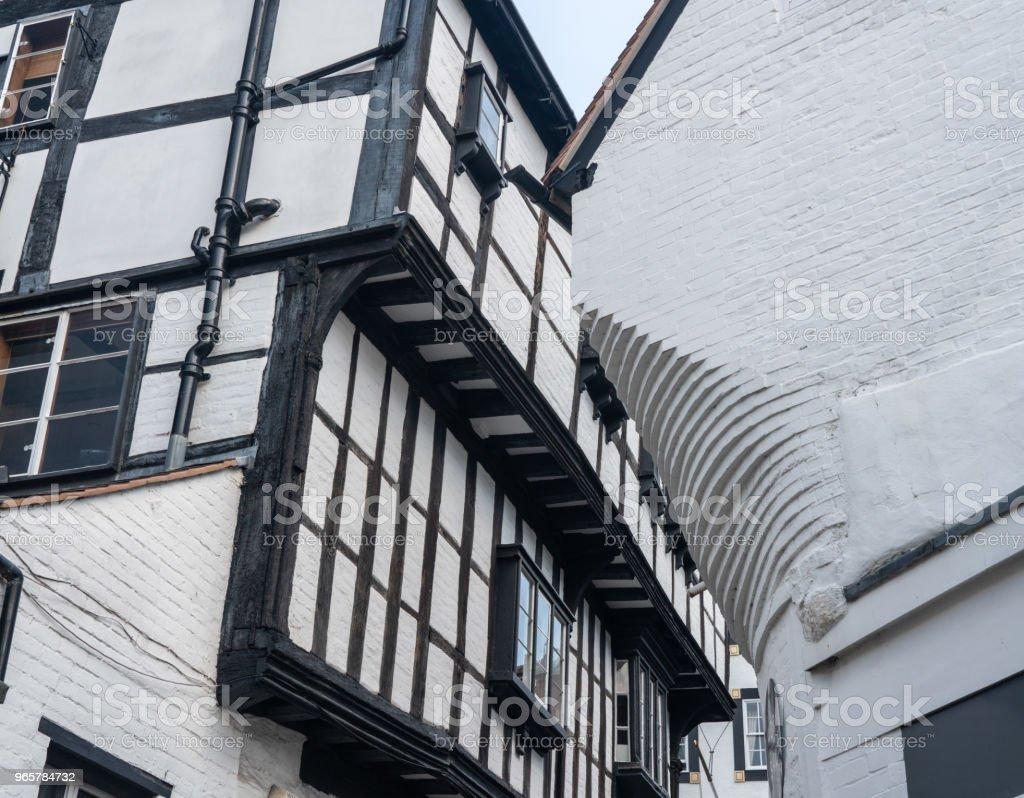 Smalle Grope Lane in Shrewsbury, Shropshire - Royalty-free Aan het werk Stockfoto