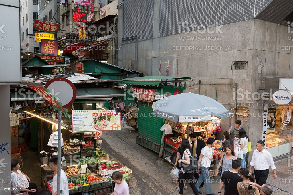 Narrow Hong Kong alley crowded with market stalls and people stock photo