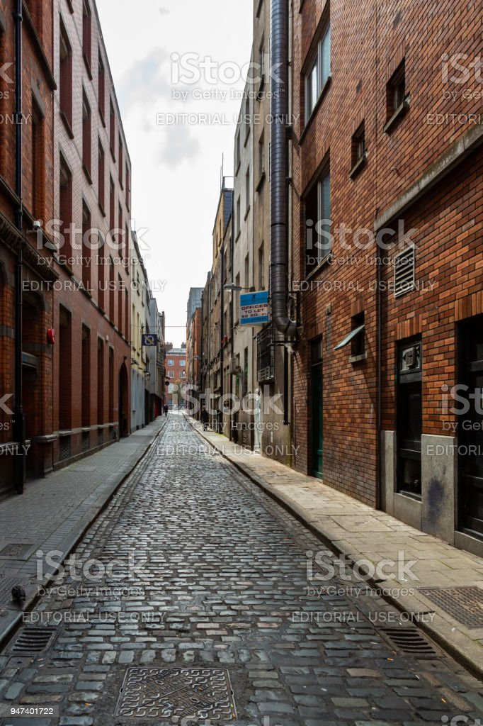 Narrow industrial city street with cobblestones. royalty-free stock photo
