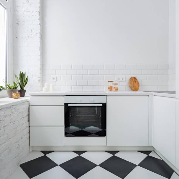 Narrow kitchen with brick wall stock photo