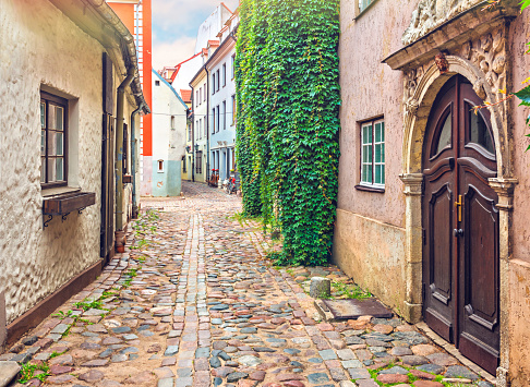 Narrow medieval street in old European city