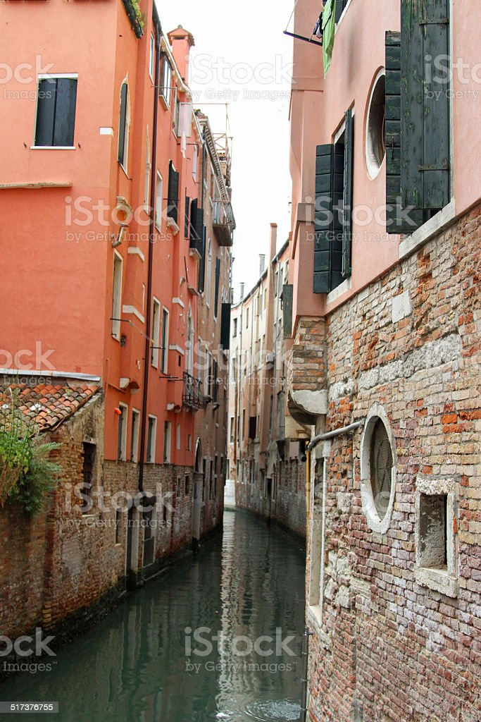 narrow navigable canal between the tall houses stock photo