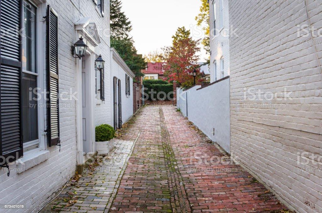Narrow Old Street Paved with Bricks stock photo