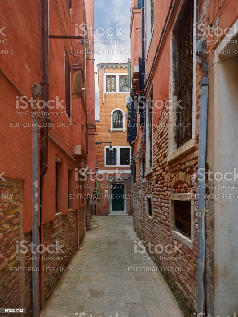 Narrow passage between colorful houses, Venice stock photo
