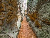 istock Narrow passage in sandstone gorge of Maze rock city in Krivoklatsko protected area, Czech Republic 690214872