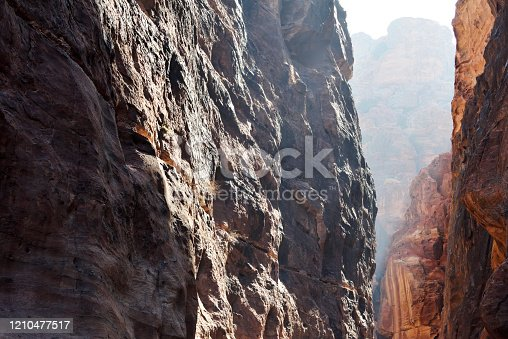 Narrow passage of rocks of Petra Canyon in Wadi Musa, Jordan