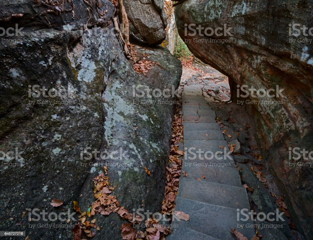 narrow passage way between rocks stock photo