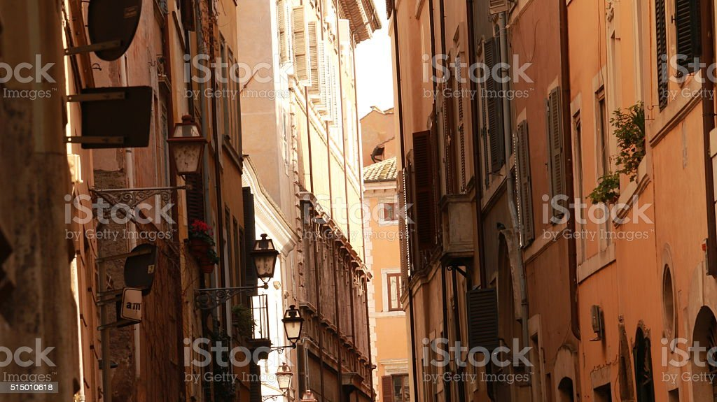 Narrow romantic street of the old town in Rome in the sunlight stock photo