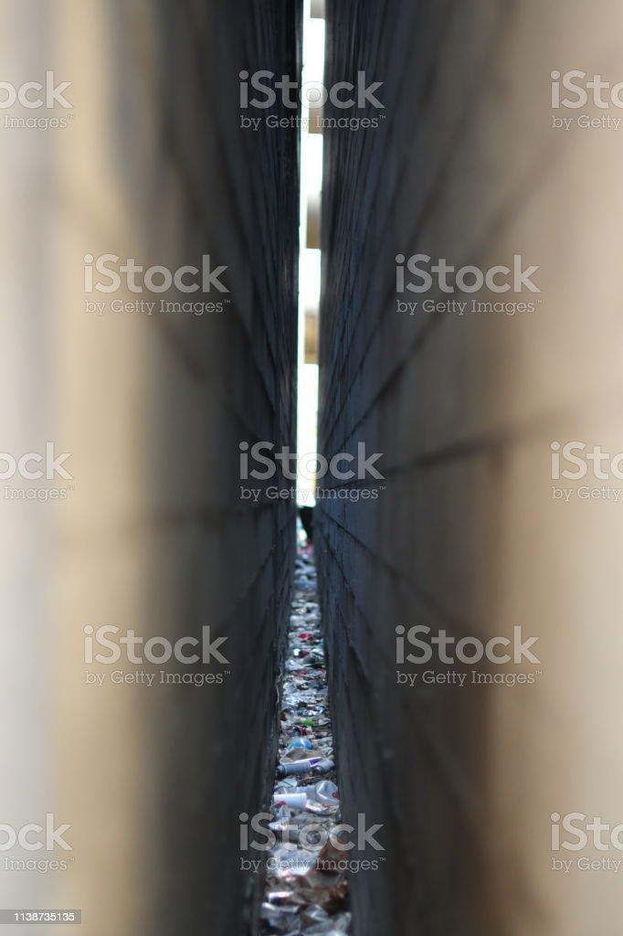 Narrow Space Between Buildings with Debris stock photo