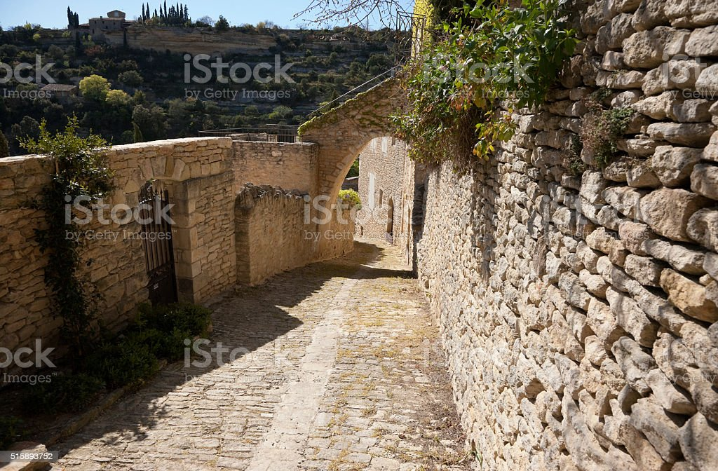 Narrow stone streets of Gordes, Provence, France stock photo