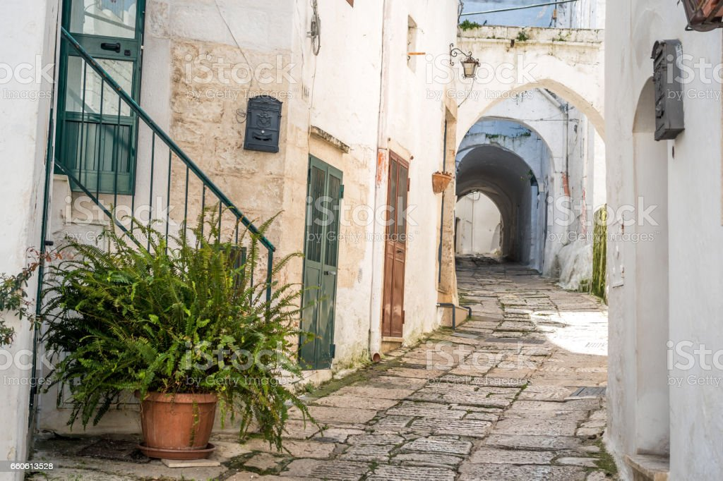 Narrow street and tunnel in romantic white city of Ostuni royalty-free stock photo