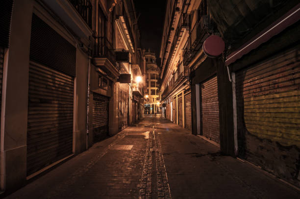 Narrow street at night in the old town Narrow street at night in the old town alley stock pictures, royalty-free photos & images