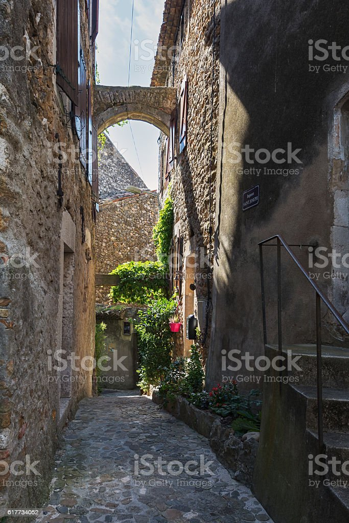 Narrow street in a small French town. stock photo