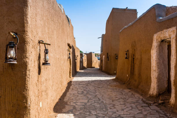 A narrow street in a traditional Arab mud brick village, Al Majmaah, Saudi Arabia The restored streets in the Munikh Castle suburbs saudi arabia stock pictures, royalty-free photos & images