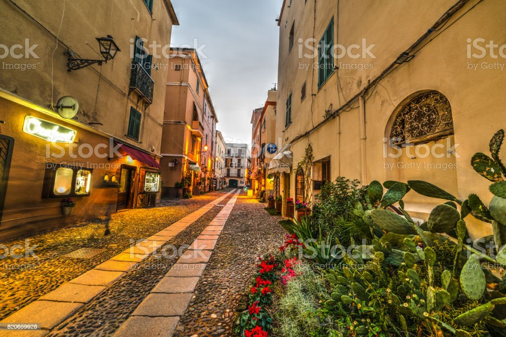 Narrow street in Alghero old town stock photo