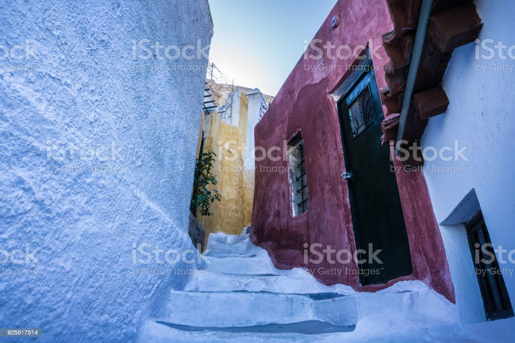 Narrow street in Anafiotika neighborhood in Plaka of Athens in Greece stock photo