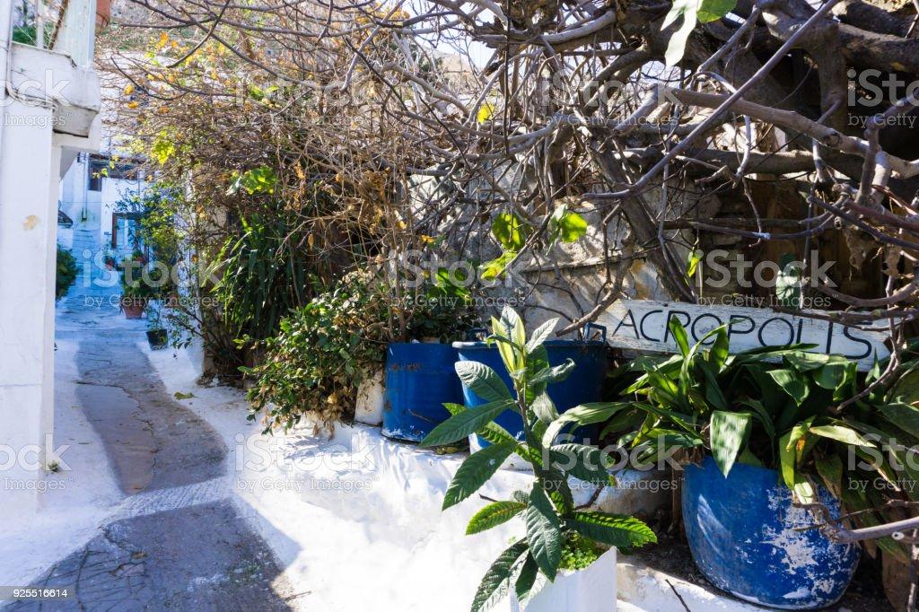 Narrow street in Anafiotika neighborhood in Plaka of Athens leading to the Acropolis in Greece stock photo