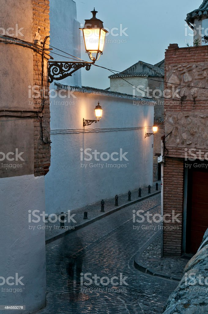 Narrow street in Granada's Albaicin quarter stock photo