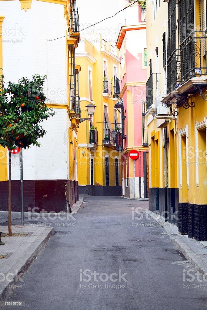 Narrow street in historical center of Sevilla royalty-free stock photo