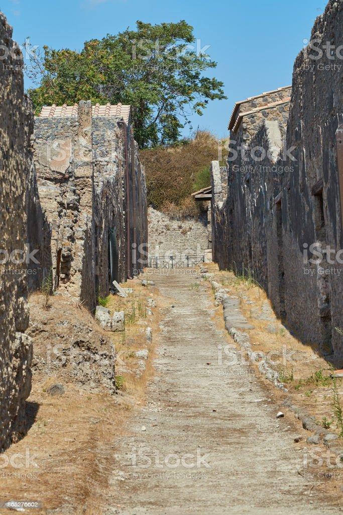 Narrow street in Pompeii stock photo