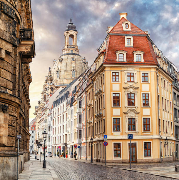 A narrow street in the historic center of Dresden in the morning without pedestrians and cars A narrow street in the historic center of Dresden in the morning without pedestrians and cars zwanger stock pictures, royalty-free photos & images