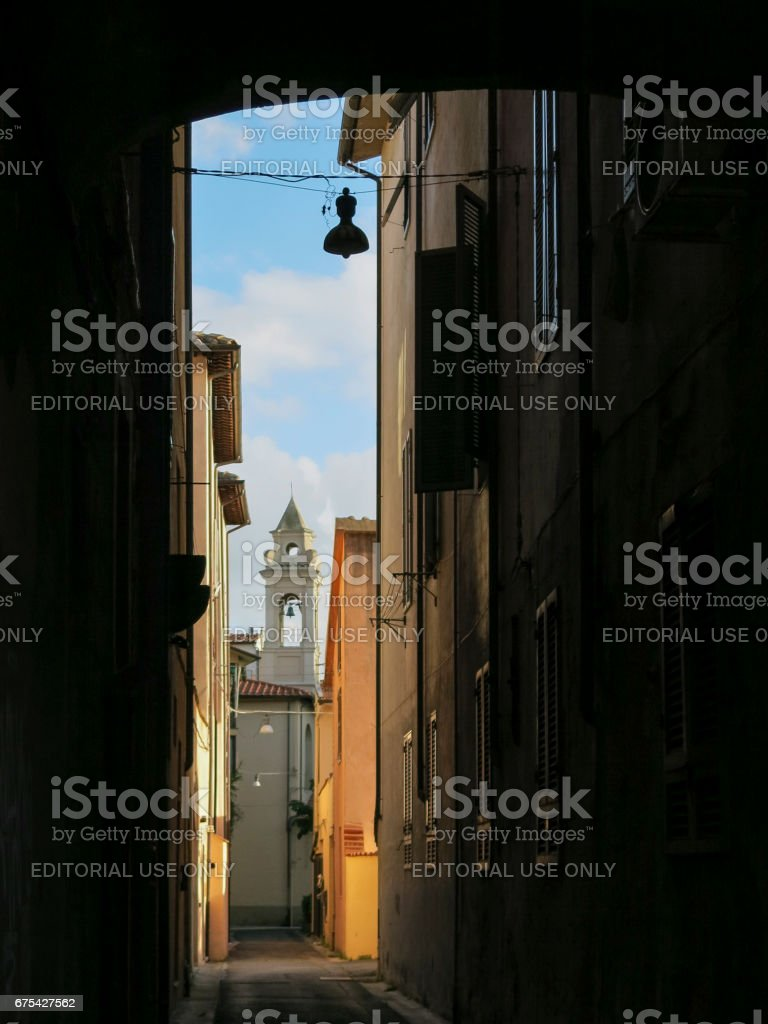 Narrow street in the old town of Pisa, Tuscany Italy royalty-free stock photo
