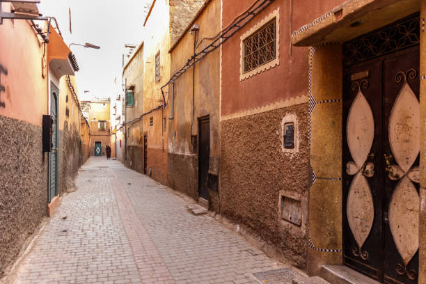 narrow street in the suq of marrakesh - north africa stock photos and pictures