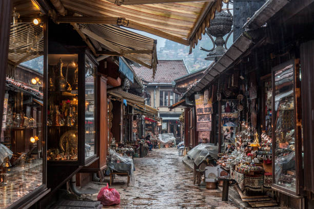Narrow street of the Bascarsija district of Sarajevo, with typical metal copper crafts being produced with ottoman techniques. Bascarsija is the symbol of Sarajevo, with its oriental architecture Picture of one of Bascarsija's streets. Bascarsija is Sarajevo's old bazaar and the historical and cultural center of the city. It was built in the 15th century during the foundation of the city bosnia and hercegovina stock pictures, royalty-free photos & images
