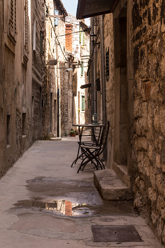 istock Narrow street of the old town, Sibenik, Croatia 1168004699