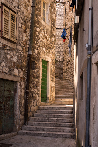 istock Narrow street of the old town, Sibenik, Croatia 1168004704