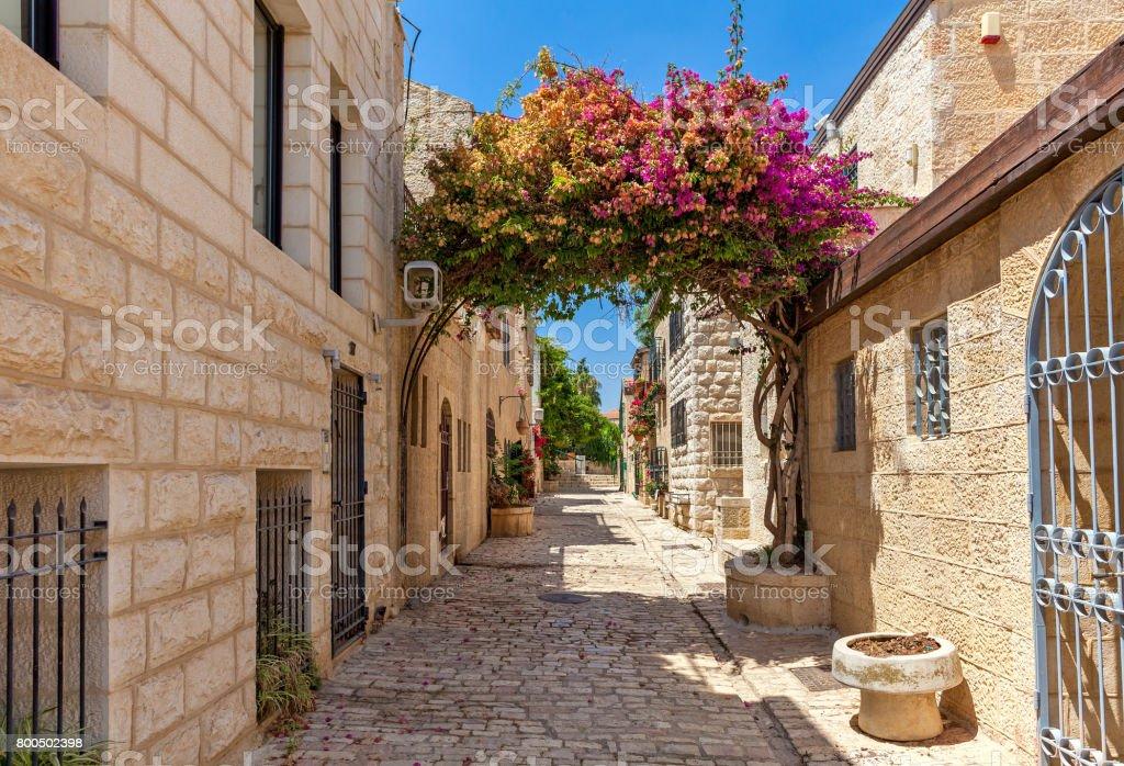 Narrow street of Yemin Moshe district in Jerusalem. stock photo