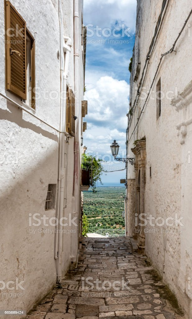 Narrow street, Ostuni, Italy stock photo
