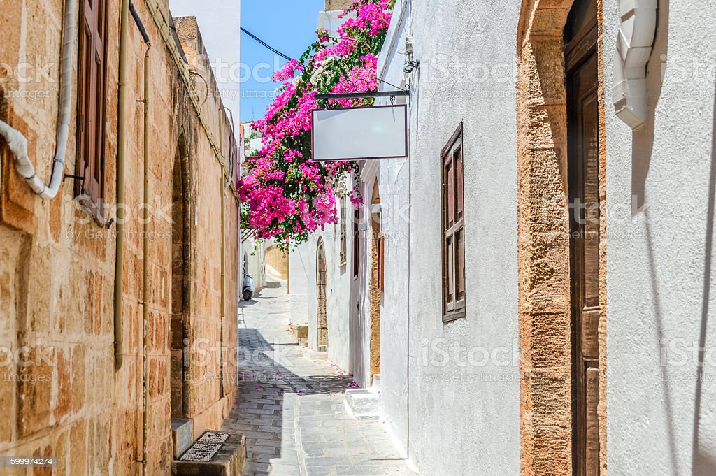 Narrow streets and traditional architecture of Lindos - Rhodes, Greece stock photo