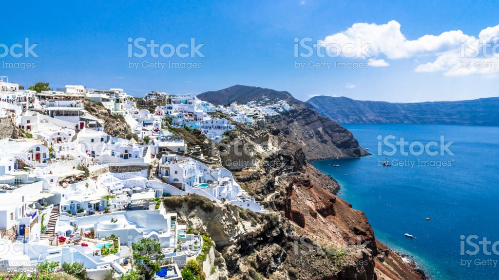 Narrow streets of Oia on the steep banks stock photo