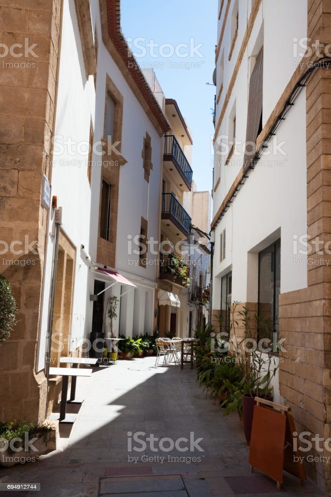narrow streets of typically Spanish Javea old town on Costa Blanca Spain stock photo