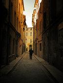 An old man  walks down