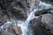 Narrow Torrential Rapid River with Waterfall, Mountain Stream, Canyoneering, Rafting