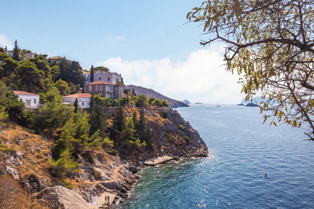 Narrow traditional houses on the rock in the town of Hydra, Hydra island, Greece stock photo