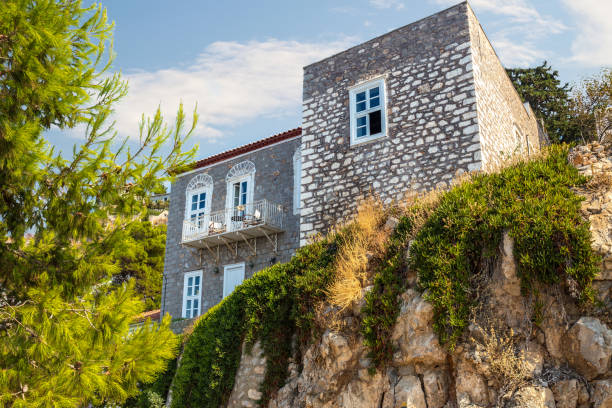 Narrow traditional stone house in street in the town of Hydra, Hydra island, Greece stock photo