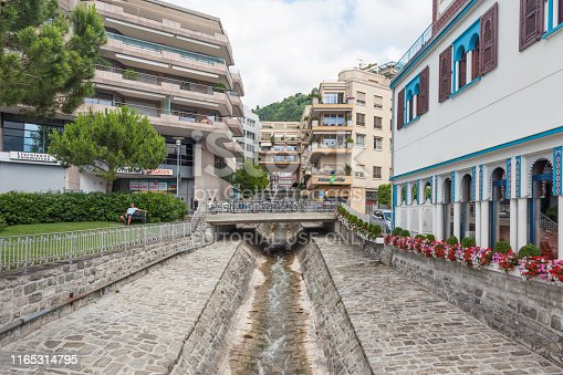 istock Narrow water stream flowing down through stone paved riverbed built to protect from flash flooding in Montreux town,  Vaud, Switzerland 1165314795