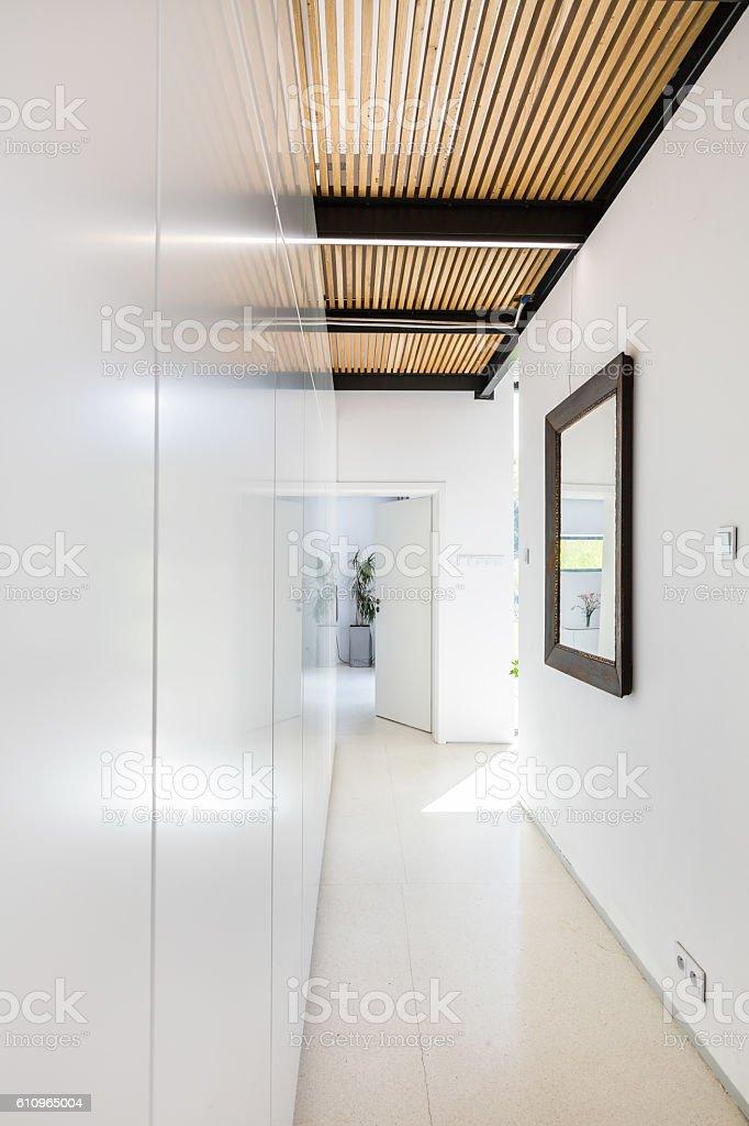 Narrow white hall stock photo