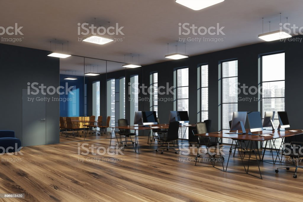 Narrow windows, open space office corner gray stock photo