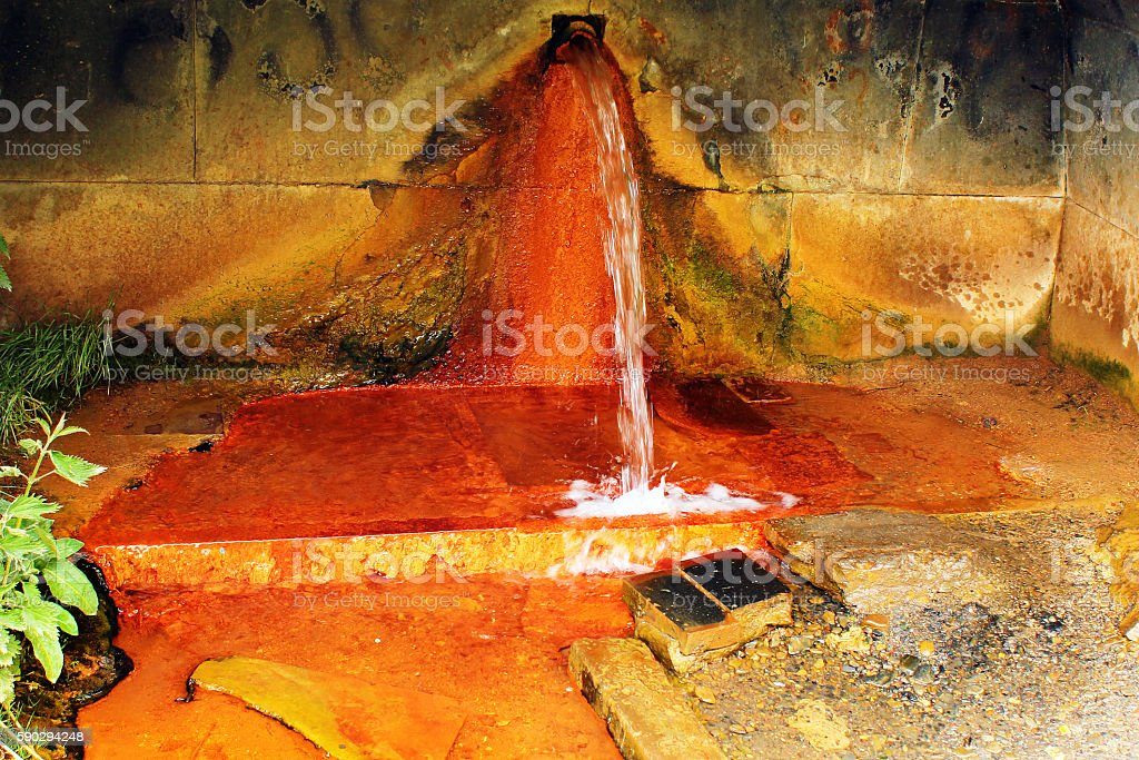 Narzan mineral water spring in Caucasus mountains, Georgia Стоковые фото Стоковая фотография